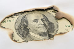 Banknote and burnt paper Royalty Free Stock Images