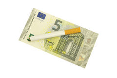 Banknote and cigarette Stock Photos