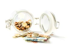 Banknote and coins in glass jar on white background. Concept for Money and Finance Royalty Free Stock Photography