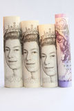 Banknote Coulumn. Rolled British five, ten and twenty pound notes standing on their ends Royalty Free Stock Photography