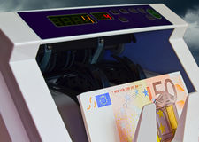 BankNote Counter. Photograph of a banknote cash counter machine, euro currency Stock Photo