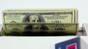 Banknote counter, dollars and blanks white form on white background stock video footage