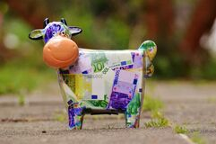Banknote Cow on Gray Conncrete Road royalty free stock photography