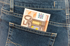 Banknote 50 euro sticking out of the blue jeans pocket Royalty Free Stock Images