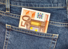 Banknote 50 euro sticking out of the jeans pocket Stock Photos
