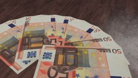 Banknote fan of fifty euro on the wooden floor. 3D illustration stock images