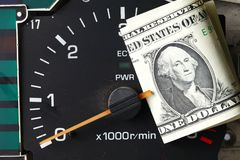 Banknote gesetztes Tachometermessgerät stockfotos