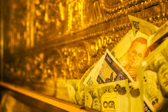 Banknote in golden room Royalty Free Stock Photos