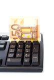 Banknote inserted into keyboard for online payment Royalty Free Stock Photography