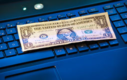 Banknote on keyboard Stock Image