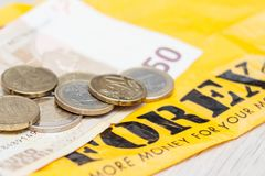 Banknote money 50 euros and coins euro cents are after the exchange of forex royalty free stock photo