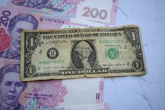 Banknote in one dollar and Ukrainian 200 hryvnia royalty free stock photos