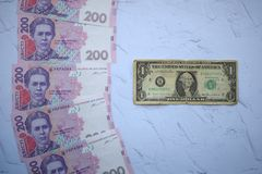 Banknote in one dollar and Ukrainian 200 hryvnia. Banknote one dollar and Ukrainian 200 hryvnia, the concept of exchange rates stock images