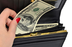 Banknote one hundred dollars in a black purse Royalty Free Stock Photography
