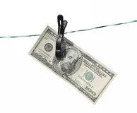 The banknote one hundred dollars on the clothesline Royalty Free Stock Photography