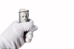 Banknote one hundred dollars, sandwiched in hand Stock Image