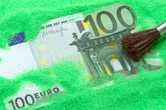 Banknote one hundred euros in the green sand Stock Photos