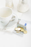 Banknote in payment for coffee Royalty Free Stock Image