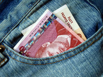 Banknote in the pocket. Banknote in the jeans pocket Royalty Free Stock Image