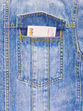 Banknote in pocket of jean jacket Stock Photos