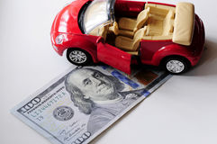 Banknote and red car stock photos