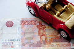 Banknote and red car Royalty Free Stock Photo