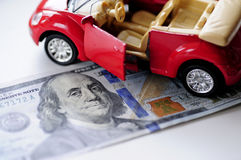 Banknote and red car Royalty Free Stock Image
