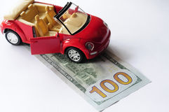Banknote and red car Stock Image