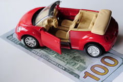 Banknote and red car Royalty Free Stock Photography