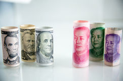 Banknote roll, dollar roll and yuan roll. economy chess competition concept.money roll for playing chess. Stock Photography