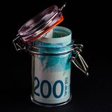 Banknote of 200 shekels in a glass jar Stock Image