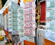 Banknote for thai Buddhist merit made. In Buddhist Temple in Chiangmai, Thailand Stock Photo