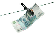 The banknote of a thousand Russian rubles on the clothesline Royalty Free Stock Images