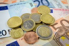 Banknote und Münze Stockfoto