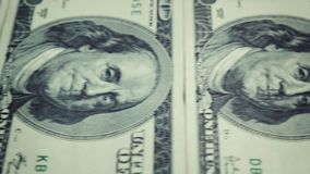 Banknote 100 us dollar conveyor movement from the left to the right side with a stop. Close-up portrait of Benjamin Franklin stock video