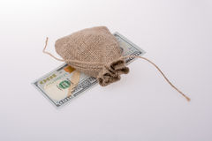 Banknote of US dollar under a sack Stock Photography