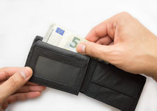 Banknote from wallet. Male hands taking out money from the wallet stock photos