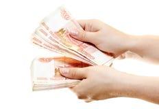 Banknoten in den Händen Lizenzfreies Stockbild