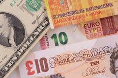 Banknoten in den verschiedenen Währungen Lizenzfreies Stockfoto