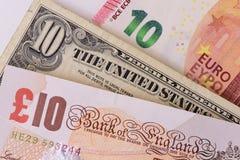 Banknoten in den verschiedenen Währungen Stockfoto