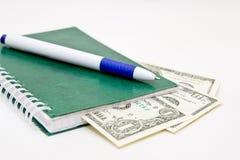 Banknoten der Feder und einiger Dollar Lizenzfreies Stockbild