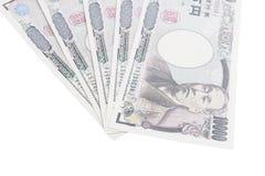 Banknoten der japanischen Yen auf weißem Hintergrund Stockbilder
