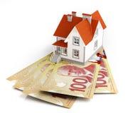 Banknoten des kanadischen Dollars unter Haus Stockbild