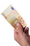 Banknoten in seiner Hand lizenzfreie stockbilder