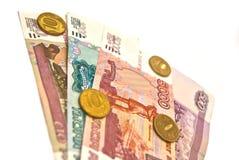 Banknoten und Münzen stockbilder