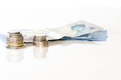 Banknoten und Münzen Lizenzfreie Stockfotografie