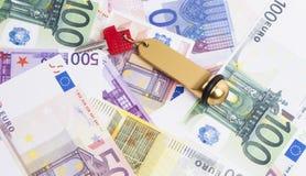 Banknoten und Schlüssel Lizenzfreie Stockfotos