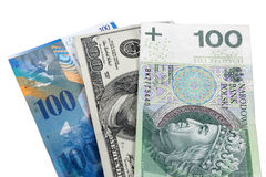 Banknoten von 100 Dollar, von polnischem Zloty und von Schweizer Franken Lizenzfreie Stockfotos
