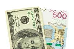 Banknoten von 100 USD und von 500 PLN Stockbild
