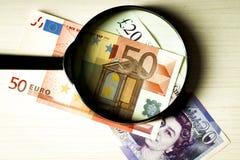 Banknoteneuro und das britische Pfund Stockbild